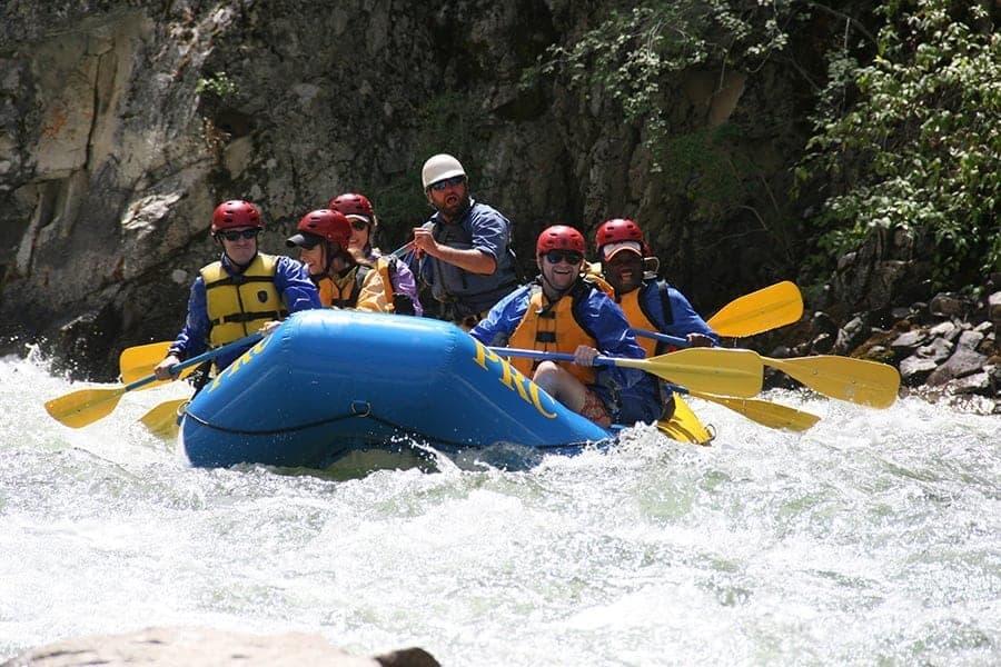 team members on white water raft